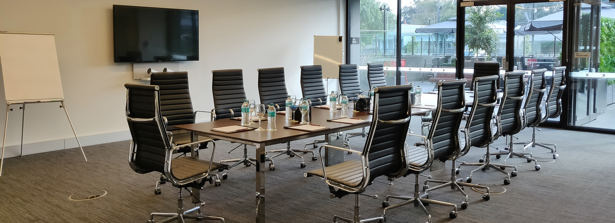 7.5m X 9.4m conference room equipped for dual screen video conferencing